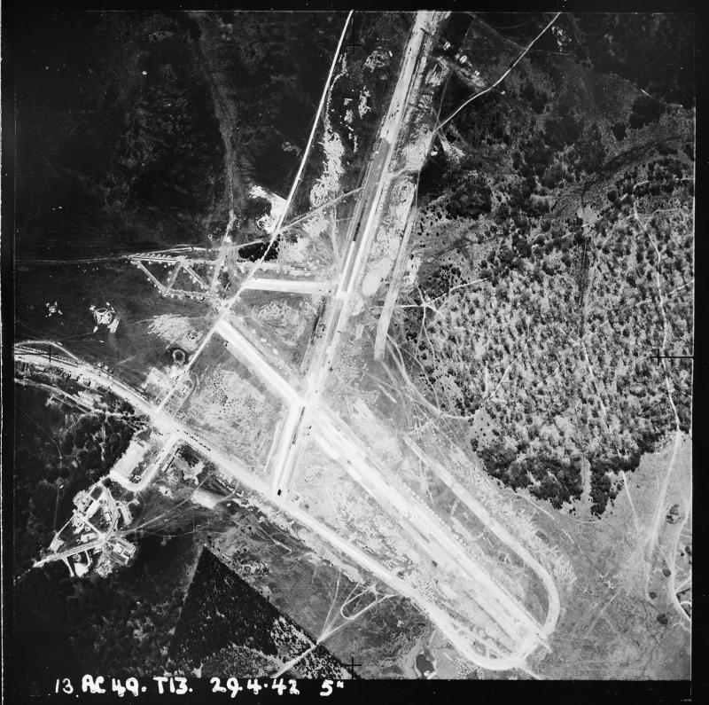 Aerial photograph of the north end of Stoney Cross airfield looking west, the runways and perimeter are under construction, 29 April 1942. Photograph taken by sortie number RAF/13T/AC49. English Heritage (RAF Photography).