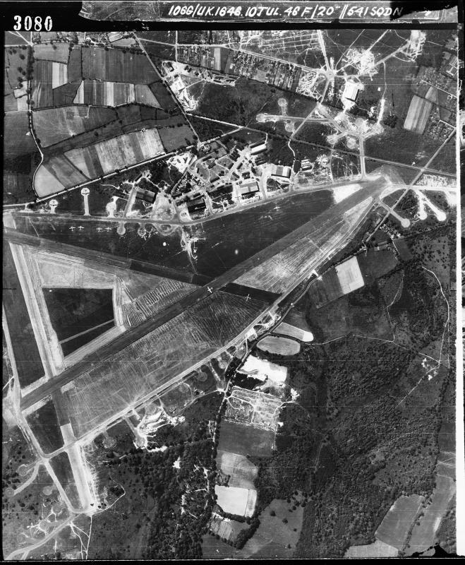 Aerial photograph of Aldermaston airfield looking south. This is post WW2 shot when the airfield had been taken over by BOAC as an aircrew training base. Dakotas, Vikings and Yorks were in use. The control tower is in the centre with T2 hangars above, 10 July 1946. Photograph taken by No. 541 Squadron, sortie number RAF/106G/UK/1646. English Heritage (RAF Photography).