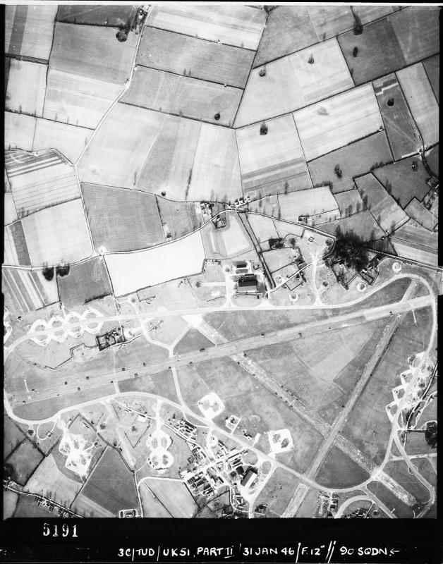 Aerial photograph of Attlebridge airfield, looking north, the fuel store and a T2 hangar are in the upper centre, 31 January 1946. Photograph taken by No. 90 Squadron, sortie number RAF/3G/TUD/UK/51. English Heritage (RAF Photography).