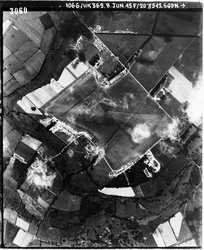 Aerial photograph of Bodney airfield, looking south east, the barrack sites are in the top centre of the image, 8 June 1945. Photograph taken by No. 542 Squadron, sortie number RAF/106G/UK/369. English Heritage (RAF Photography).