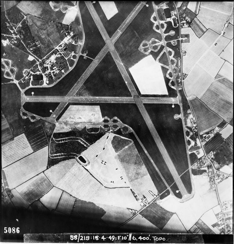 Aerial photograph of Boxted airfield, looking south west, the ammunition dump and bomb dump are at the bottom of the image, 18 April 1949. Photograph taken by No. 58 Squadron, sortie number RAF/58/215. English Heritage (RAF Photography).