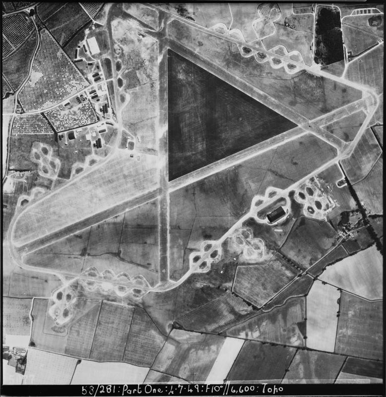 Aerial photograph of Boreham airfield, looking east, there is a T2 hangar in the centre right of the image, 4 July 1949. Photograph taken by No. 50 Squadron, sortie number RAF/58/281. English Heritage (RAF Photography).