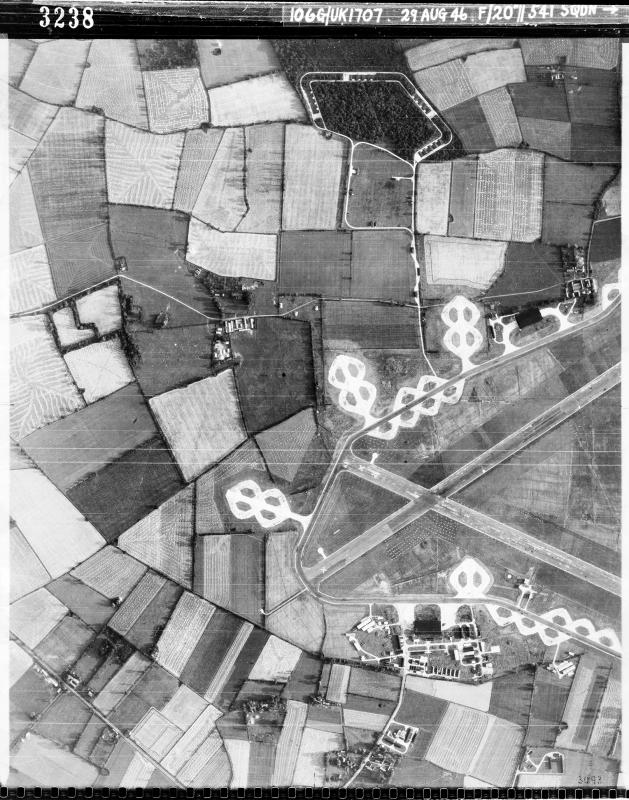 Aerial photograph of the west end of Fersfield (Winfarthing) airfield, looking north, the bomb dump is at the top, the technical site- with T2 hangar- at the bottom, 29 August 1946. Photograph taken by No. 541 Squadron, sortie number RAF/106G/UK/1707. English Heritage (RAF Photography).