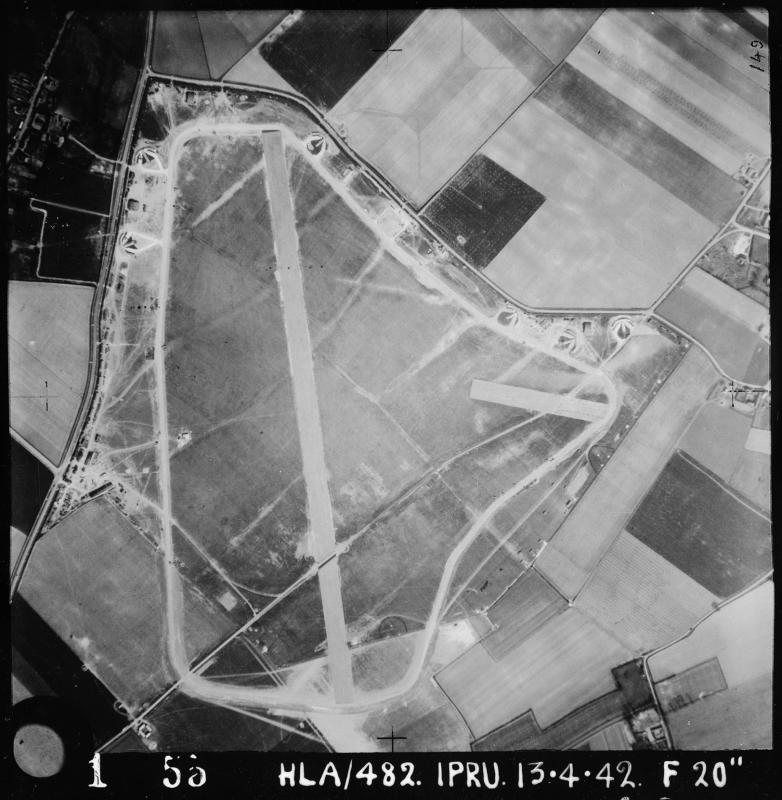 Aerial photograph of Bottisham airfield, looking east, the PSP runway runs vertically up the image, 13 April 1942. Photograph taken by No. 1 Photographic Reconnaissance Unit, sortie number RAF/HLA/482. English Heritage (RAF Photography).