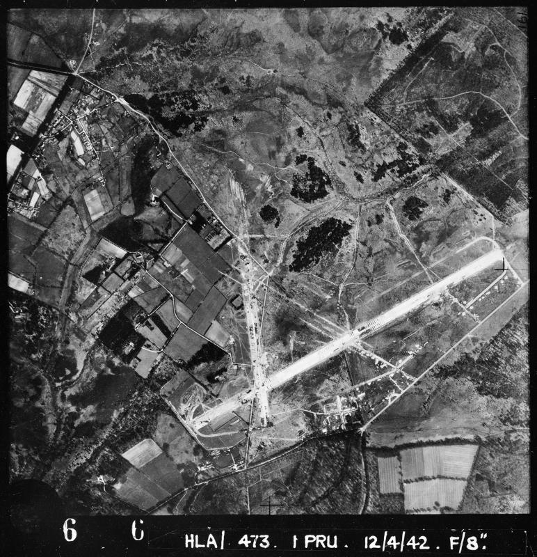 Aerial photograph of Holmsley South airfield looking north, the runways and perimeter are under construction, 24 April 1942. Photograph taken by No. 1 Photographic Reconnaissance Unit, sortie number RAF/HLA/498. English Heritage (RAF Photography).