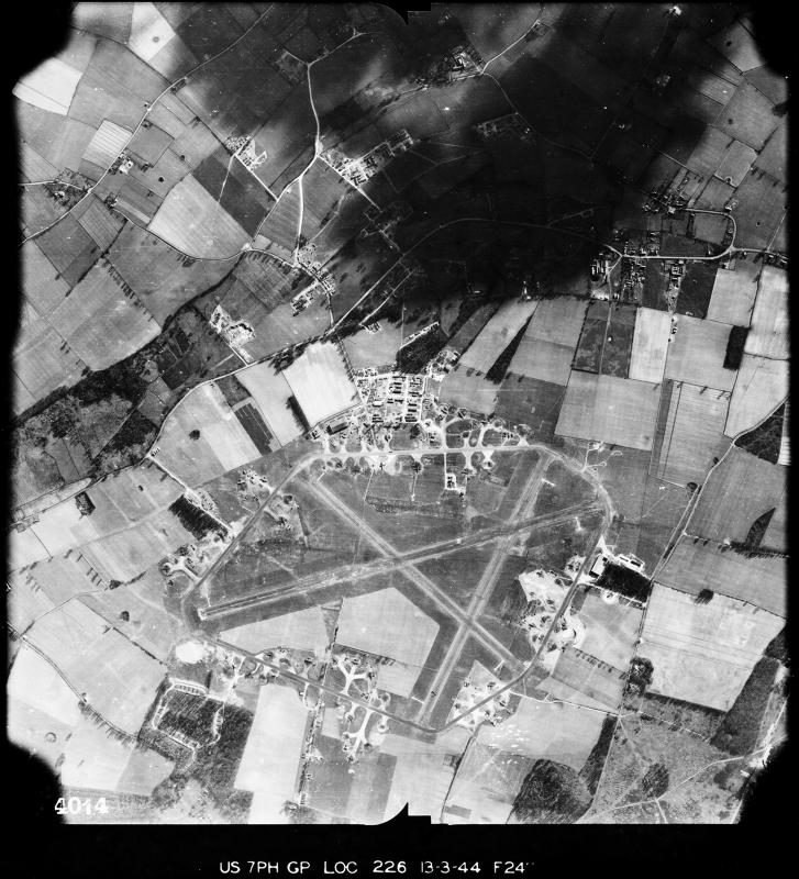 Aerial photograph of Knettishall airfield looking south, the bomb dump is bottom left, 13 March 1944. Photograph taken by 7th Photographic Reconnaissance Group, sortie number US/7PH/GP/LOC226. English Heritage (USAAF Photography).