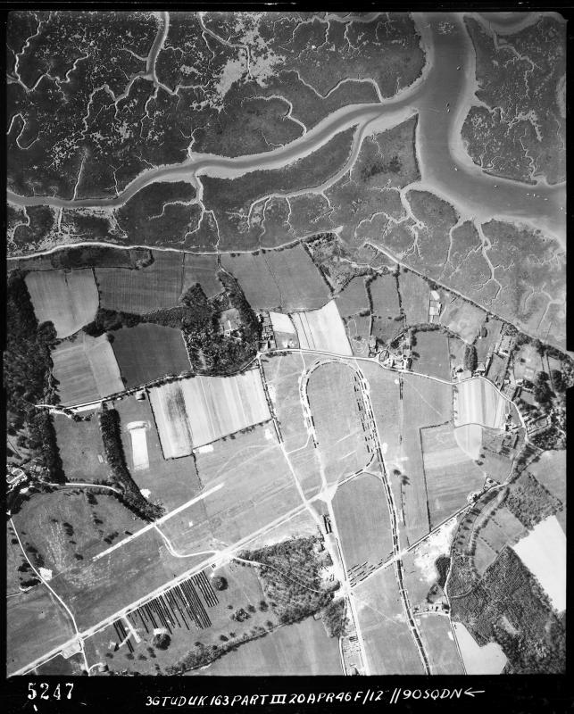 Aerial photograph of the south end of Lymington airfield looking south, Pylewell Lake is at the top, 20 April 1946. Photograph taken by No. 90 Squadron, sortie number RAF/3G/TUD/UK/163. English Heritage (RAF Photography).