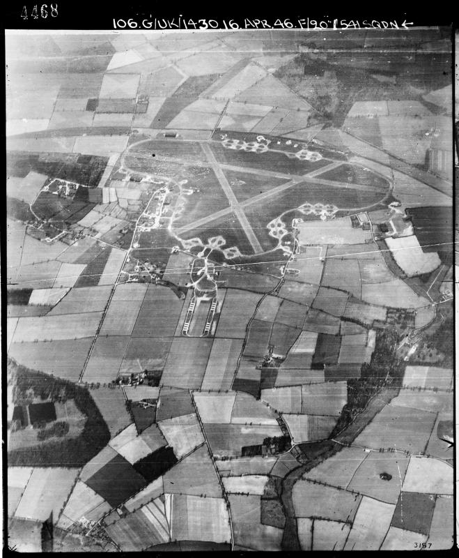Oblique aerial photograph of Oulton airfield looking south the main runway runs horizontally, the bomb dump is at the bottom of the airfield, 16 April 1946. Photograph taken by No. 541 Squadron, sortie number RAF/106G/UK/1430. English Heritage (RAF Photography).