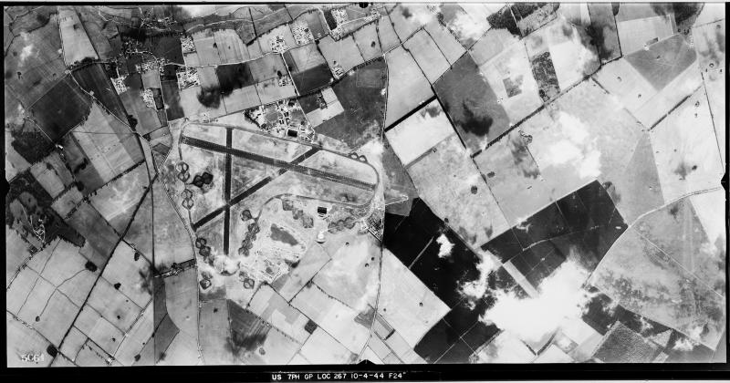 Aerial photograph of North Pickenham airfield looking south east, the technical site and control tower are at the top, 10 April 1944. Photograph taken by 7th Photographic Reconnaissance Group, sortie number US/7PH/GP/LOC267. English Heritage (USAAF Photography).