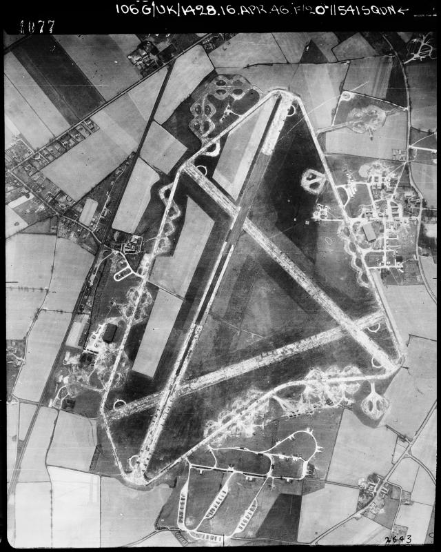 Aerial photograph of Rackheath airfield looking south, the administrative site, barracks sites and technical site with a T2 hangar is on the right, the bomb dump and ammunition dump are at the bottom, the fuel store, firing butts and second T2 hangar are on the left, 16 April 1946. Photograph taken by No. 541 Squadron, sortie number RAF/106G/UK/1428. English Heritage (RAF Photography).