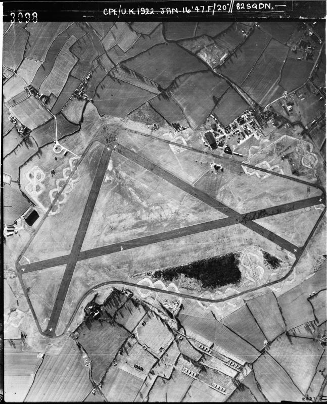 Aerial photograph of Wethersfield airfield looking south the bomb dump is at the bottom of the airfield, the main runway runs horizontally, 16 January 1947. Photograph taken by No. 82 Squadron, sortie number RAF/CPE/UK/1922. English Heritage (RAF Photography).