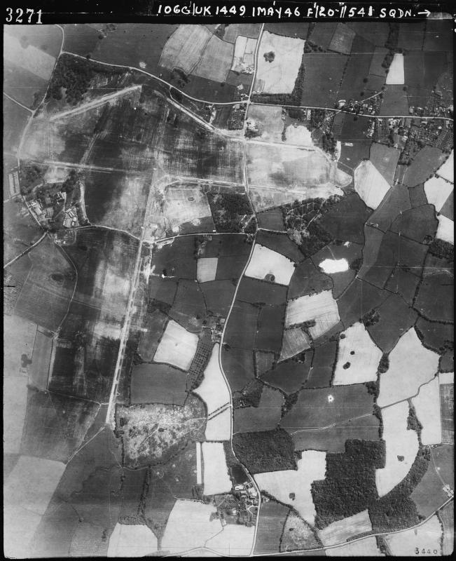 Aerial photograph of Woodchurch airfield looking south, the main runway runs vertically, 1 May 1946. Photograph by No 541 Squadron, sortie number RAF/106G/UK/1449. English Heritage (RAF Photography).