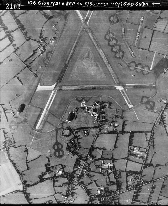 Aerial photograph of Blakehill Farm airfield looking south west, the technical site with T2 hangar and barrack sites are at the bottom, 6 September 1946. Photograph taken by No. 540 Squadron, sortie number RAF/106G/UK/1721. English Heritage (RAF Photography).