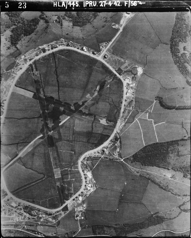 Aerial photograph of Charmy Down airfield looking east, the control tower and airfield code are bottom left, 27 April 1942. Photograph taken by No. 1 Photographic Reconnaissance Unit, sortie number RAF/HLA/445. English Heritage (RAF Photography).