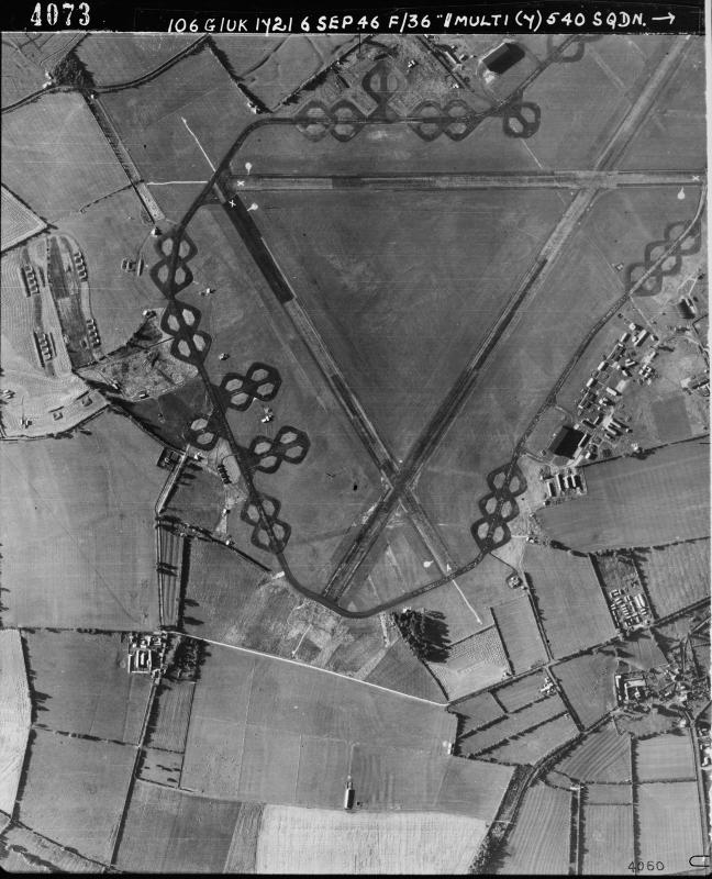 Aerial photograph of Down Ampney airfield looking south, the bomb dump is on the left, the technical site with a T2 hangar is on the right, 6 September 1946. Photograph taken by No. 540 Squadron, sortie number RAF/106G/UK/1721. English Heritage (RAF Photography).