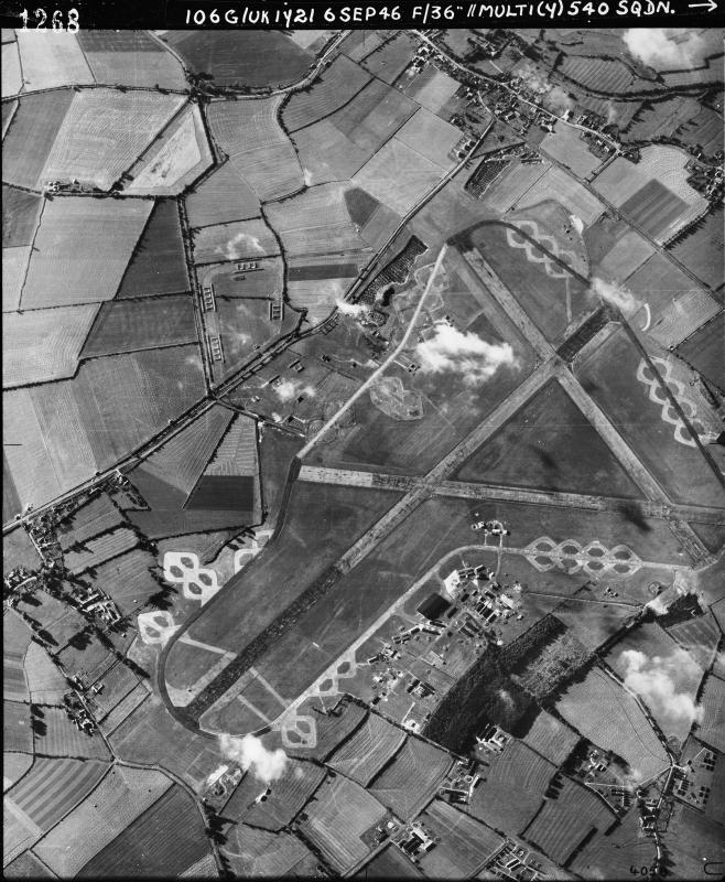 Aerial photograph of Fairford airfield looking north east, the bomb dump and ammunition dump are at the top, the technical site and control tower are at the bottom, barrack sites are bottom right, 6 September 1946. Photograph taken by No. 540 Squadron, sortie number RAF/106G/UK/1721. English Heritage (RAF Photography).