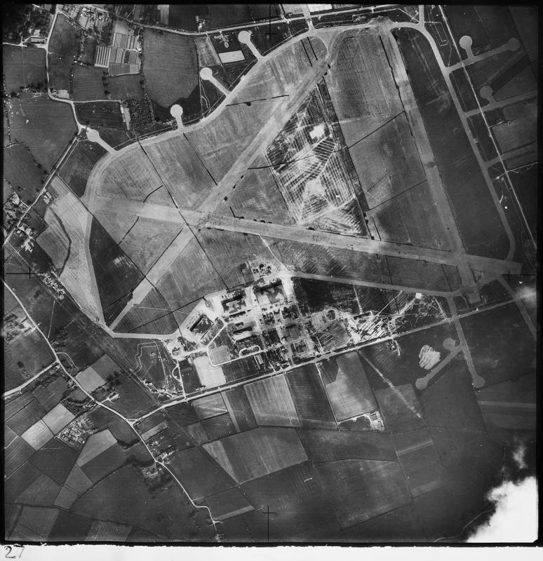 Aerial photograph of Goxhill airfield looking north west, the control tower and technical site with two T2 hangars and a J-Type hangar is at the bottom, barrack sites are top left, 8 June 1942. Photograph taken on sortie number RAF/UK753. English Heritage (RAF Photography).
