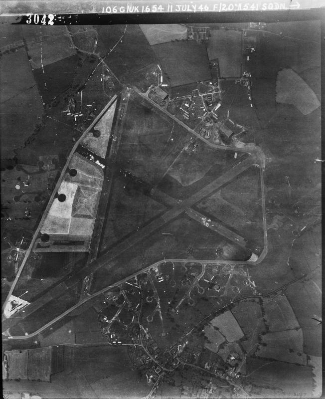 Aerial photograph of Keevil airfield looking south, the technical site with two T2 hangars is at the top, barrack sites are at the bottom, 11 July 1946. Photograph taken by No. 541 Squadron, sortie number RAF/106G/UK/1654. English Heritage (RAF Photography).