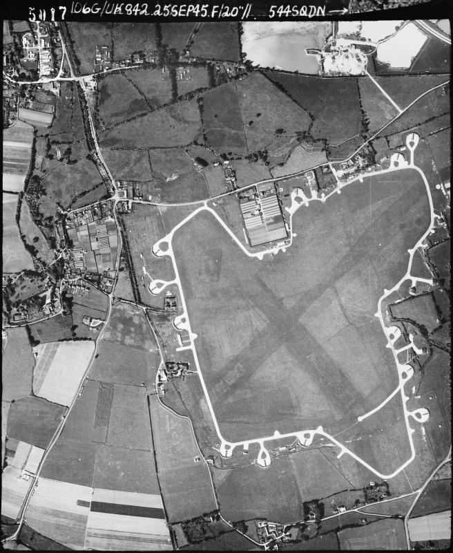 Aerial photograph of Merston airfield looking north west, the control tower and technical site are at the top of the airfield, 25 September 1945. Photograph taken by No. 544 Squadron, sortie number RAF/106G/UK/842. English Heritage (RAF Photography).