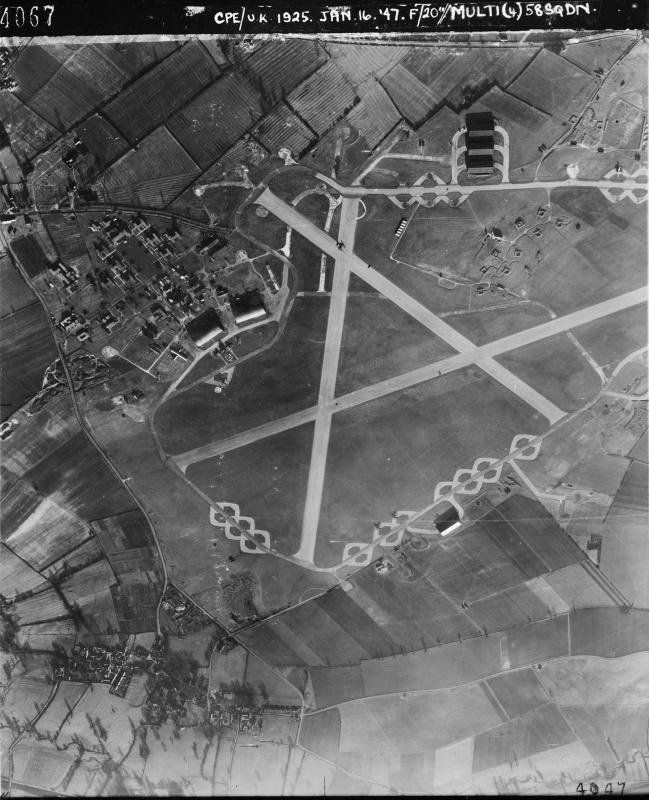 Aerial photograph of North Luffenham airfield looking north, the control tower is in front of the T2 hangars on the left, there are three more T2 hangars on the right, 16 January 1947. Photograph taken by No. 58 Squadron, sortie number RAF/CPE/UK/1925. English Heritage (RAF Photography).