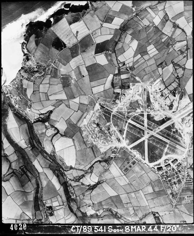 Aerial photograph of St Eval airfield looking north west, the technical site with three C-Type hangars is bottom right of the airfield, 8 March 1944. Photograph taken by No. 541 Squadron, sortie number RAF/CT/89/541. English Heritage (RAF Photography).