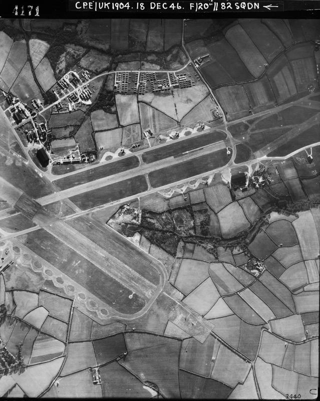 Aerial photograph of St Mawgan airfield looking south, the technical site with a T2 hangar is on the left, 18 December 1946. Photograph taken by No. 82 Squadron, sortie number RAF/CPE/UK/1904. English Heritage (RAF Photography).