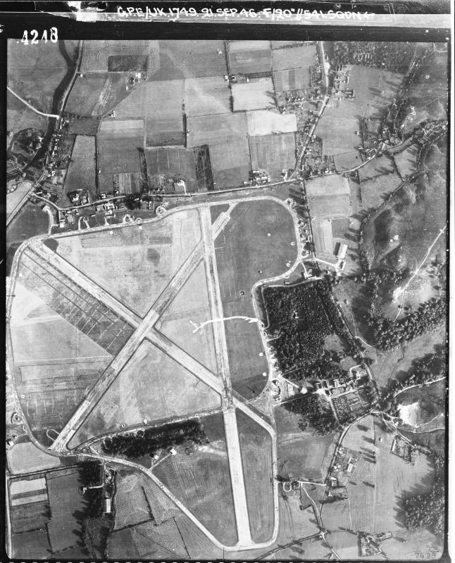 Aerial photograph of Ibsley airfield looking north, the control tower and airfield code are in the centre of the image, 21 September 1946. Photograph taken by No. 541 Squadron, sortie number RAF/CPE/UK/1749. English Heritage (RAF Photography).