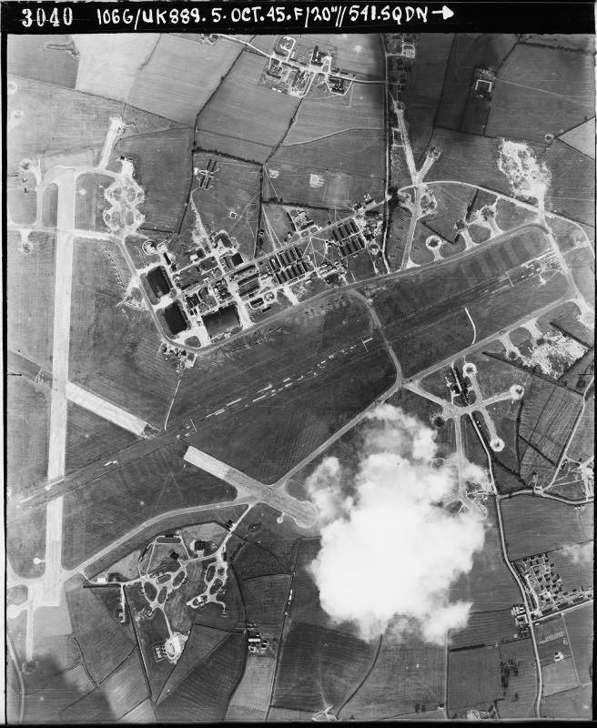 Aerial photograph of the east end of Molesworth airfield looking north, the control tower and two T2 hangars are right of the vertical runway, 5 October 1945. Photograph taken by No. 541 Squadron, sortie number RAF/106G/UK/889. English Heritage (RAF Photography).