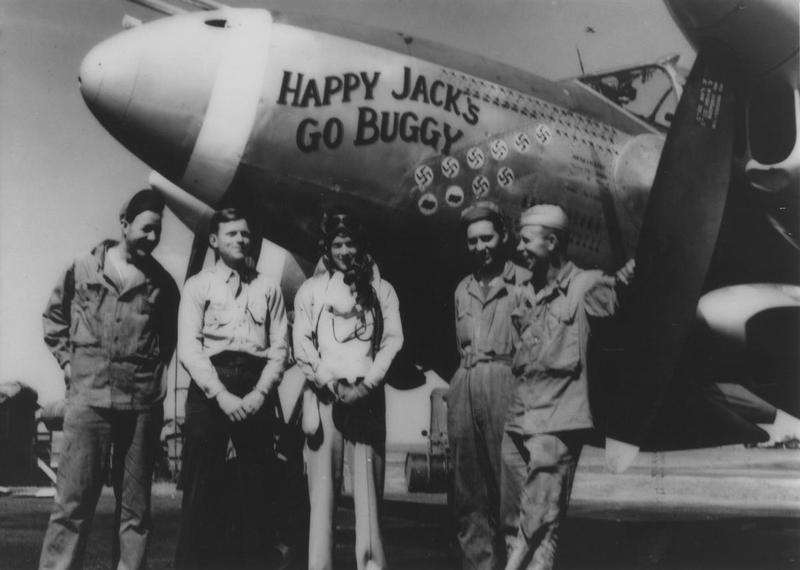 Captain Jack M. Ilfrey, one of the COs of the 79th Fighter Squadron, 20th Fighter Group, at Kings Cliffe air base. He stands with other crew members beside P-38J Lightning (MC-O, serial number 43-28431), called