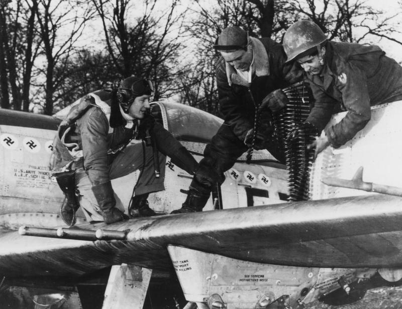 Capt Ken Dahlberg watches Sgt Harry Phillips and SSgt George Spikos of the 353rd FS 354th FG load ammo into a P-47D Thunderbolt.