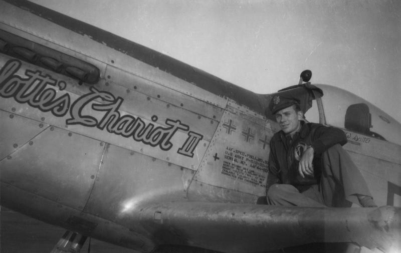 Lieutenant Cary Salter, a pilot of the 354th Fighter Group with his P-51 Mustang (FT-π), serial number 44-63747) nicknamed