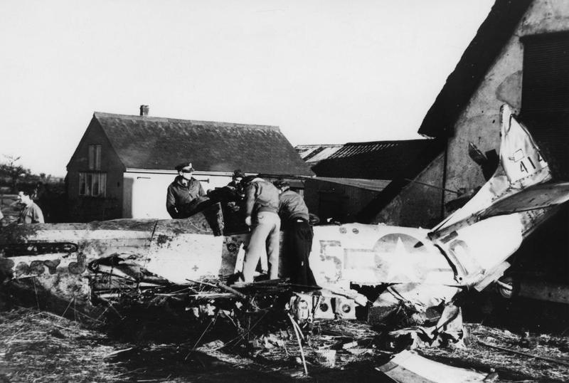 Ground crew attend to a crashed P-51 Mustang nicknamed