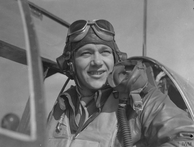 Capt. Nicholas Megura of the 334th Fighter Squadron, 4th Fighter Group, in cockpit, at Debden air base, 8 March 1944. Caption on reverse: Pilots of the P-51s. Lt.Col. Donald J. M. Blakeslee's Mustang Group. Associated Press photo shows: Lt. Nicholas Megura, aged 24, of 108 Broad Street, Ansonia, Conn., has been on first two raids over Berlin and shot down two planes each time. WOR265648. 8344EM. Stamp (Passed for publication - General Section, Press & Censorship Bureau, 9 March 1944)
