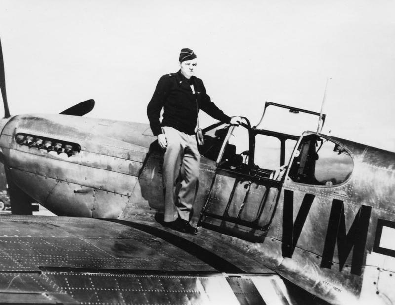 Brigadier-General Francis Griswold stands on the wing of a P-51 Mustang (VM-?) of the 495th Fighter Training Group. Handwritten caption on reverse: 'Brig Gen Francis Griswold P-51B-1-NA 43-12406 8th F.C.'