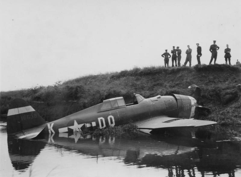 A P-47 (DQ-K, serial number 41-6538) of the 495th Fighter Training Group suffers a watery crash landing.