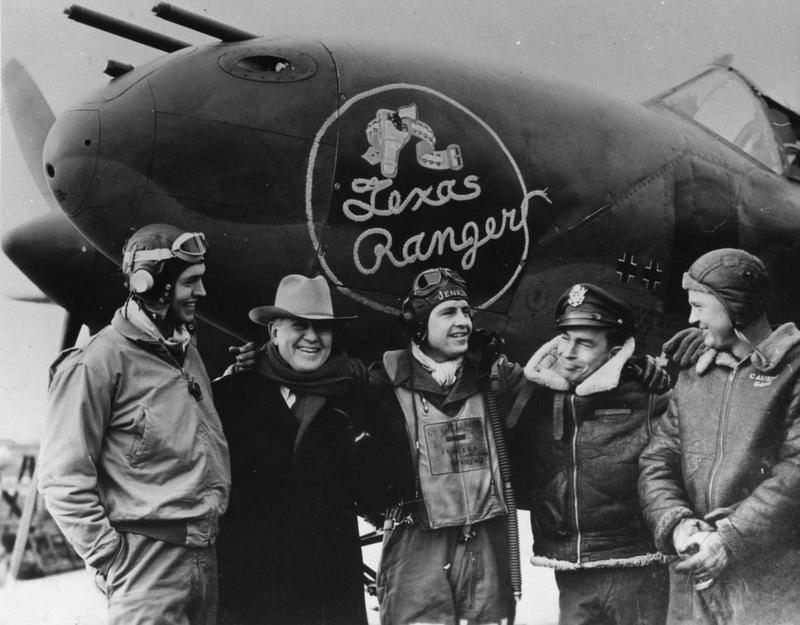 Pilots and crew of the 55th Fighter Group, stand with J. Frank Dobie, a well-known Texan writer, in front of P-38J Lightning named
