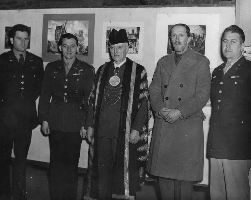 Pilots of the 55th Fighter Group meet the Mayor of Colchester, 1944 - 1945. Left to right they are: Lieutenant-Colonel Elwyn G. Righetti; Colonel George T. Crowell; Mr. Arthur W. Piper, Mayor of Colchester; unknown; Colonel Joe Huddleston.