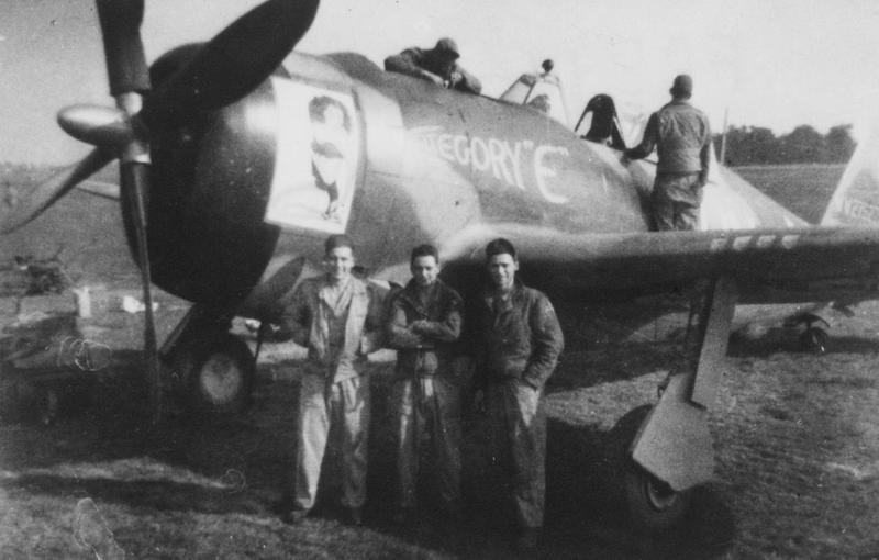 Ground crew members of the 41st Service Squadron, 56th Fighter Group, stand in front of P-47 Thunderbolt named