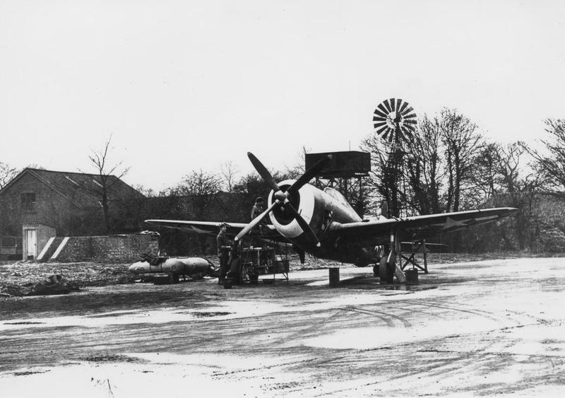 Ground crew service a 62nd Fighter Squadron P-47D Thunderbolt at Halesworth air base, home of the 56th Fighter Group, winter 1943.