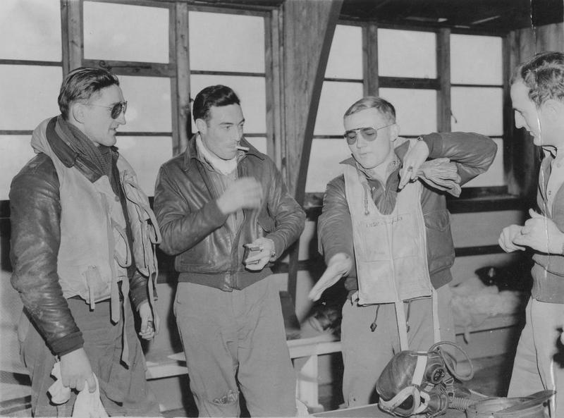 P-47 Thunderbolt pilots of the 61st Fighter Squadron chat to one another after their latest mission, at Halesworth air base where the 56th Fighter Group were stationed. Left to right they are: Lieutenant-Colonel Francis S. Gabreski, Lieutenant Eugene E. Barnum and Lieutenant Frank W. Klibbe. Passed for publication 26 November 1943.