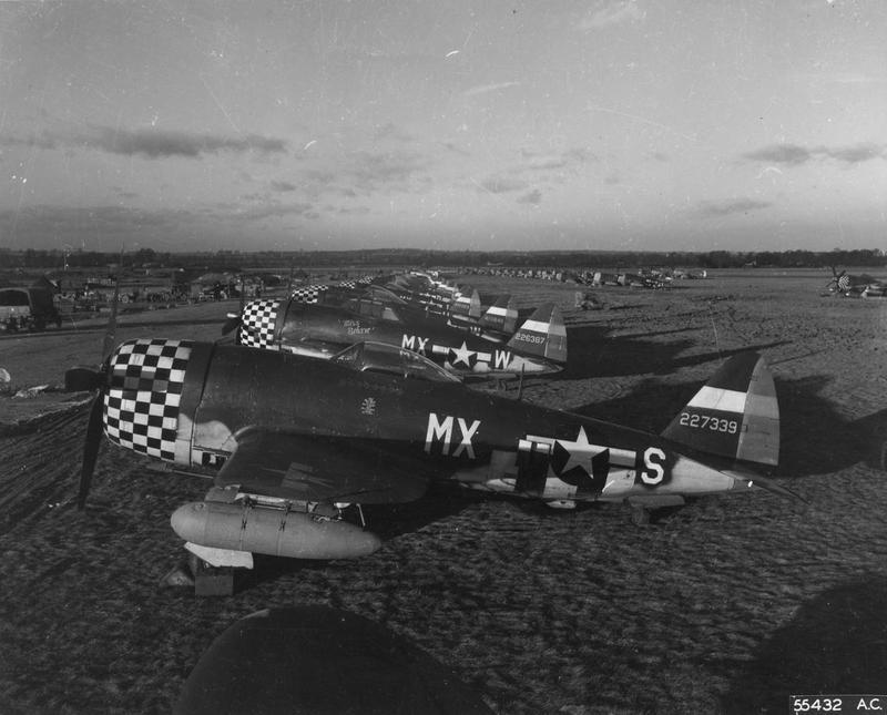 Line up of P-47 Thunderbolts of the 82nd Fighter Squadron, 78th Fighter Group, at Duxford air base. September 1944. Printed caption on reverse of print: '55432 AC - War Birds Home To Rest - Republic P-47 Thunderbolts lined up on an 8th Air Force field in England after a daylight sweep over Germany. Crews have finished inspections and refueling.'