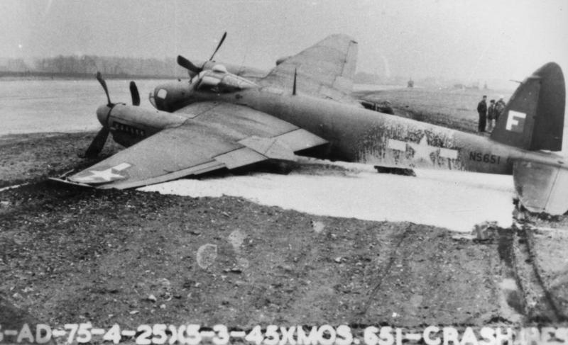 A crashed Mosquito (serial number NS651) of the 25th Bomb Group/654th Bomb Squadron at Watton, 5 March 1945. Official caption printed on image: '(G-AD-75-4-25)(5-3-45XMOS.651-CRASH.(REST.)' Additional info : Freeman's