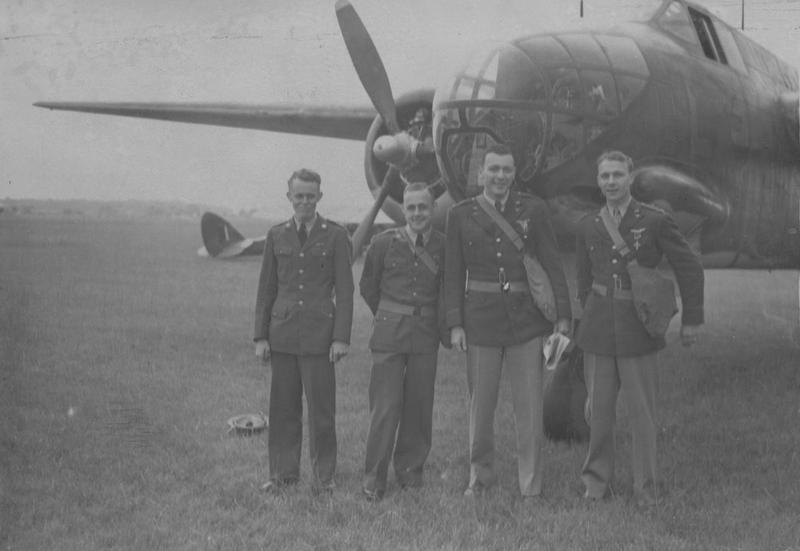 A bomber crew of the 15th Bomb Squadron, 301st Bomb Group with an RAF Douglas Boston of No 226 Squadron, after being awarded medals, 4 July 1942. From left to right, they are Sergeant Bennie B Cunningham, Sergeant Robert L Golay, Second Lieutenant Randall Dorton and Major Charles C Kegelman.   Image stamped on reverse: 'Passed for Publication 11 Jul 1942.' [stamp], 'Not to be published until 12/7/42.' [stamp], 'Keystone Press.' [stamp], 'USA (NIR)CCC.' [written annotation] and '209807.' [Censor no.]   Printed caption on reverse: 'Members of the crew of the Boston Bomber, photographed after they they had been decorated, in front of a Boston Bomber. (L to R) Sgt B B Cunningham of Tupelo, Miss; Sgt R L Golay of Fredonia ,Kansas; Second-Lieut M Dorton of Long Beach and Major Charles C Kegelman, U.S. Air Chief decorates first American airmen to operate in Europe. 11.7.42. Major General Spaatz, chief of American Air Forces in this country, today decorated a crew of a Boston bomber which took part in the 4th of July (American independence day) daylight raid on Holland.'