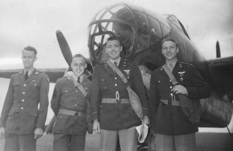 A bomber crew of the 15th Bomb Squadron, 301st Bomb Group with an RAF Douglas Boston of No 226 Squadron, after being awarded medals, 4 July 1942. 
