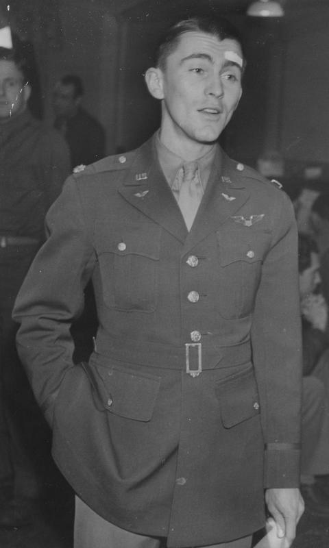 Major Eugene Allen Romig, an airman of the 303rd Bomb Group. Image stamped on reverse: 'Copyright Current Affairs Ltd.' [stamp], 'Passed for Publication 9 Apr 1943.' [stamp] and '257539.' [Censor no.] Printed caption on reverse: 'Holder of the D.F.C. and Air Medal, Major Eugene Allen Romig, aged 25, is now serving with the U.S. Army Air Force in Britain as a pilot. His home address is 910 Troy Place, N.W. Canton, Ohio, and in civil life he was a student. U 76. Not to be published before April 20, 1943.'