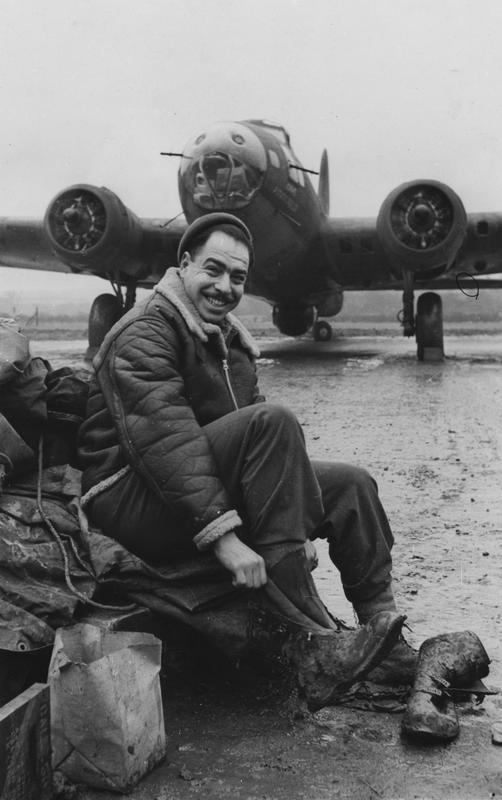 Corporal Murray S. Pearl, of the 303rd Bomb Group, with a B-17 Flying Fortress (serial number 41-24565) nicknamed