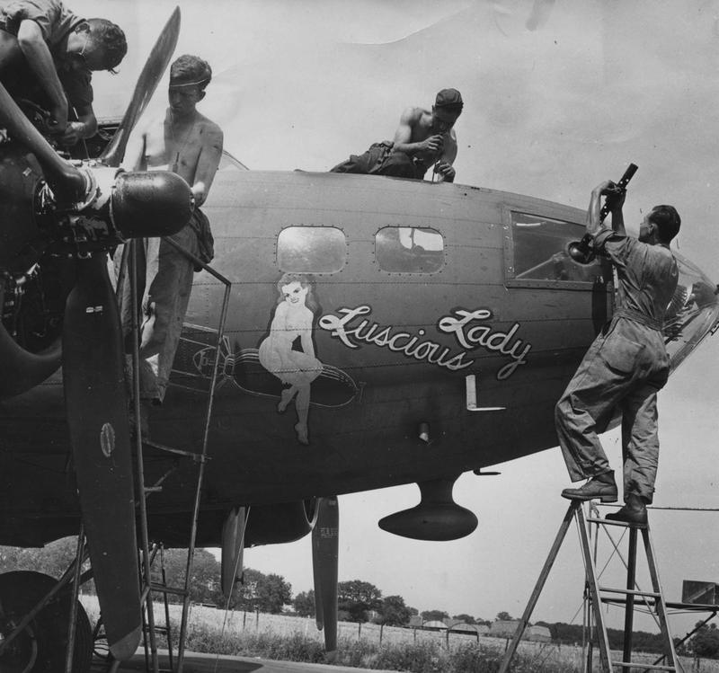Ground personnel of the 303rd Bomb Group work on a B-17 Flying Fortress (serial number 42-5081) nicknamed