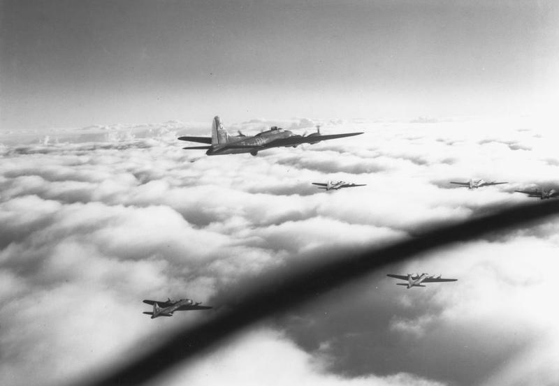 A flight of B-17 Flying Fortresses of the 303rd Bomb Group fly above the clouds on their way to Norway. B-17F (BN-T, serial number 41-24561) nicknamed