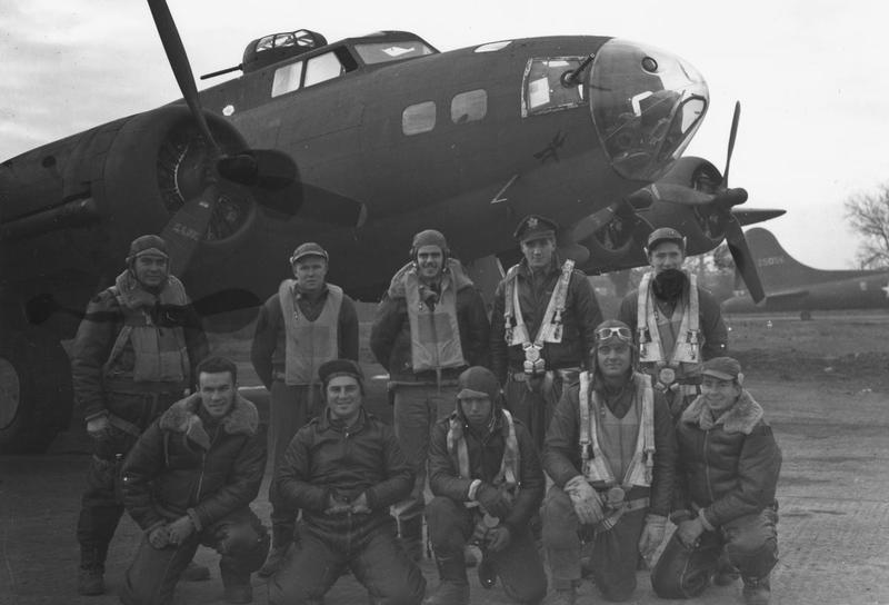 First Lieutenant Lynn H Mokler and his crew of the 305th Bomb Group with their B-17 Flying Fortress (WF-B, serial number 41-24590) Printed caption on reverse: '1st Lt. Mokler and crew of the 305th bomb Gp., are shown beside a B-17 Flying Fortress. 22 November 1942. England (GP-64A). U.S. Air Force Photo.'