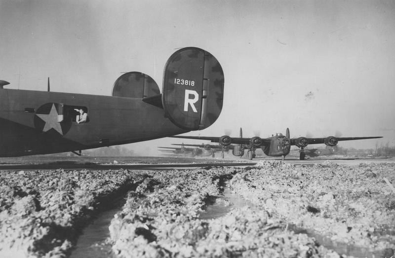 B-24 Liberators of the 44th Bomb Group line up for take off at Shipdham in 1943. A B-24 Liberator (serial number 41-23818) nicknamed
